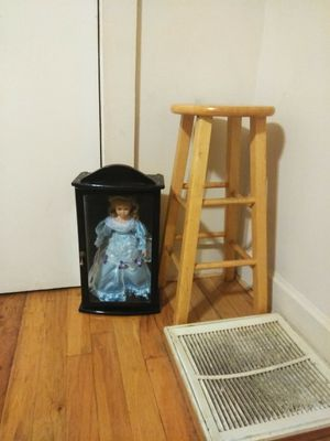 porcelain collectible doll in glass case appears to be about 2 ft tall I have the bar stool next to it as a reference of how big it is for Sale in Greer, SC