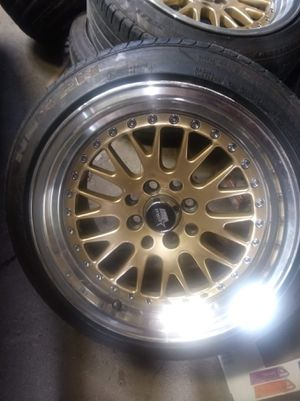 4 lug universal 15x8 for Sale in Cleveland, OH