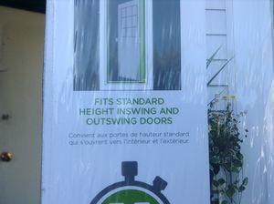 Brand new retractable screen door. Great for sun rooms & garage entry door and much more. for Sale in Mechanicsburg, OH