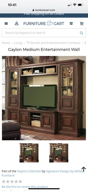All wood entertainment center for Sale in Melbourne, FL