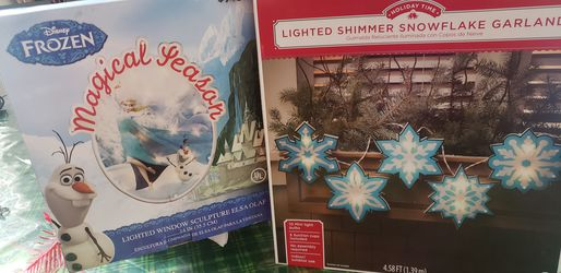 Holiday decor - lighted Elsa & Olaf window/wall sculpture and a ligjted snowflake garland for Sale in Houston,  TX