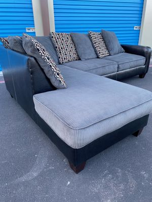 BEAUTIFUL GRAY WITH BLACK LEATHER BACKING SECTIONAL COUCH DELIVERY AVAILABLE for Sale in Las Vegas, NV