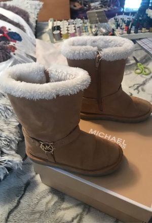 Michaels Kors boots for kids size 11 for Sale in Kissimmee, FL