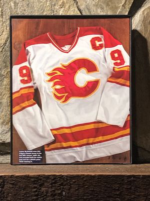 """Page from the Past : Picture of the Calgary Flames Jersey during the 1988-1989 season in """"8x10"""" glass frame. for Sale in Snellville, GA"""