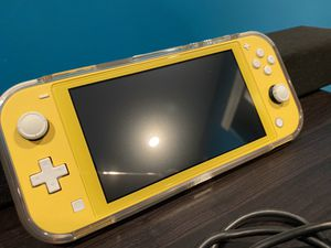 Nintendo Switch Lite Yellow: Transparent protector case that also help you to play easily, Screen proctector, no scratches or cracks of any kind, 32 for Sale in Salt Lake City, UT