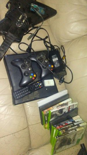 Xbox 360 with two remotes guitar dvd remote and 8 games for Sale in Sanger, CA