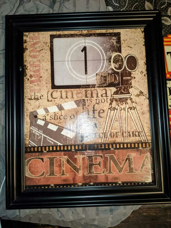 One theater picture in nice frame $20 And metal theater signs $10