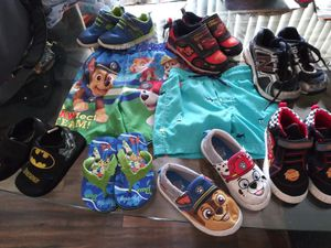 2 swimsuits , 5 sneakers an 2 sandals for Sale in Pompano Beach, FL