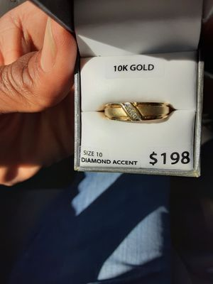 A very nice gold ring also could be a wedding ring with three chip diamonds 10 karat gold in the original box. It has been insized to an 11. for Sale in Tempe, AZ