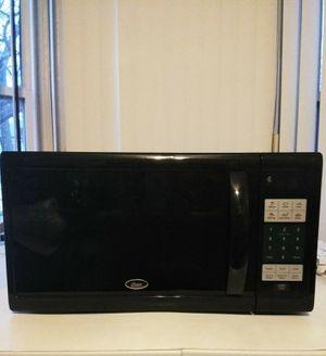 Oster 1.1 Cu. Ft. 1100W Counter Top Digital Microwave Oven - Black OGZJ1104 for Sale in Detroit, MI