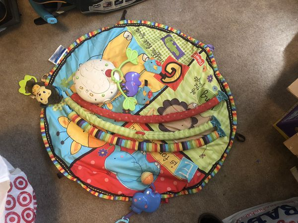 Baby play gym, plays music