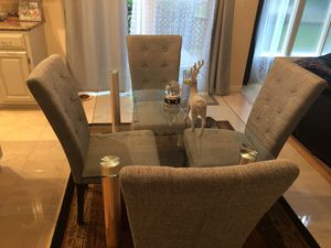 Like new - dining set - denim blue chairs - set of 4 and glass dining table for Sale in Erie, PA