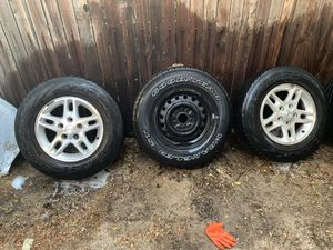 2 Jeep wheels and a spare for Sale in Denver, CO