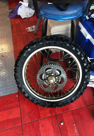 Dirt bike rim tire and complete rear wheel assembly for Sale in San Diego, CA