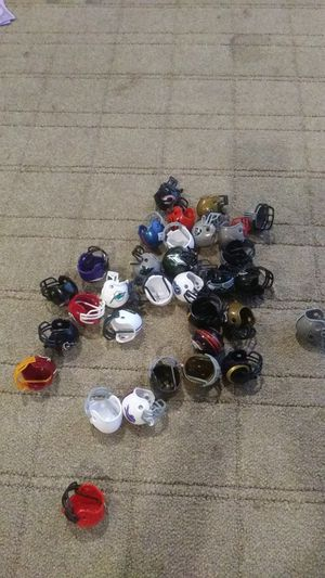 32 mini NFL HELMETS..49RS....KC.CHARGERS RAIDERS .ETCCCC... for Sale in Wildomar, CA