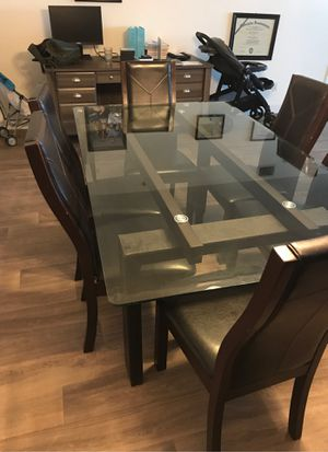 Glass dining room table with 6 chairs for Sale in Merritt Island, FL