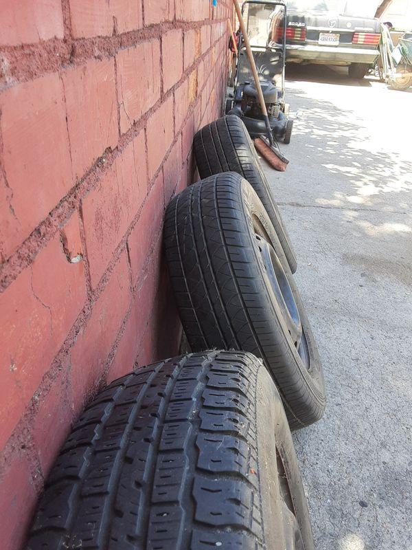 4 like new rims & tires 185 / 70 / 14