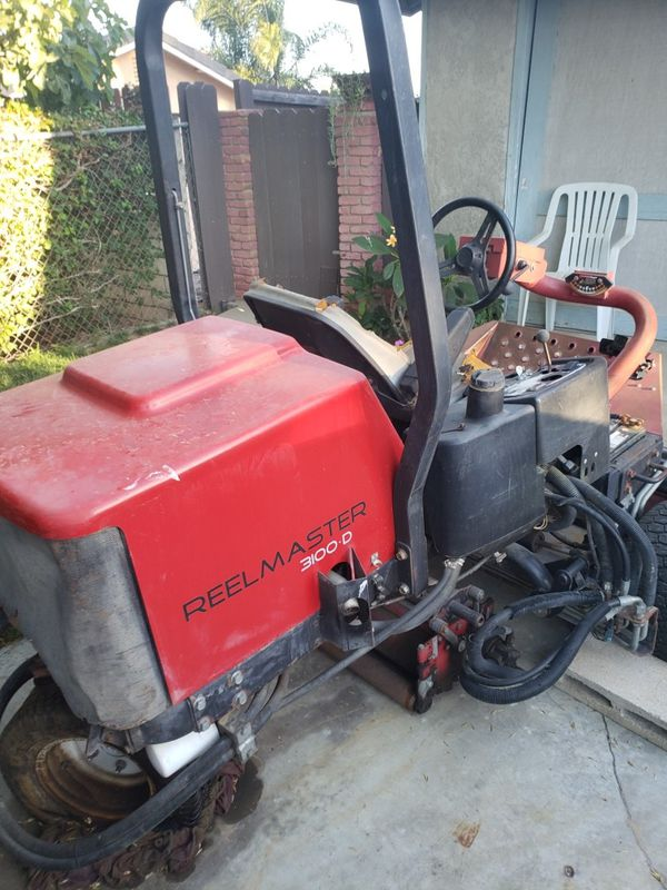 Riding lawn mower, Toro reel master 3100D.