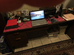 One huge dark wood desk with two drawers on the left side for Sale in Deltona, FL