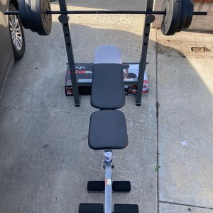 Weights XR 6.1 Combo bench and rack and 100lb Vinyl Weight Set 2x25s,2x15s and2x10s with a 5ft straight bar for Sale in West Covina, CA