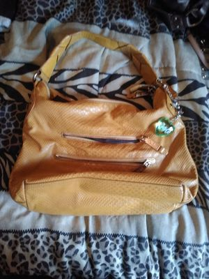$10 each OBO yellow tone snake feel lots of space n pockets.. other is coppertone, opens wide with lots of room n pockets too for Sale in Tonganoxie, KS