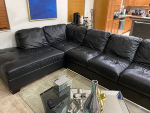 Large black sectional couch with ottoman for Sale in Boynton Beach, FL