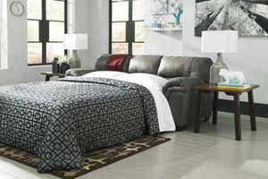 Beautiful plus sleeper sofa by 4.5 inch mattress slate color new $399.99 discounted because of a Nick on the back corner still beautiful for Sale in Phoenix, AZ