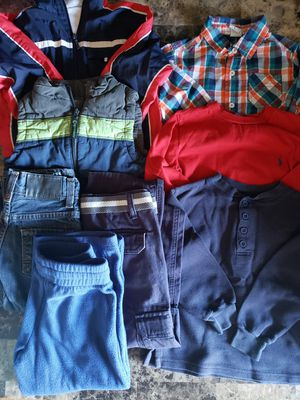 Size 4 in kids winter clothes ! $10 : 1 light jacket, a 1 vest, 1 Jean's, 1 sweat pants, 1blue pant, 2 long sleeves and 1 button up long sleeve! for Sale in Clovis, CA