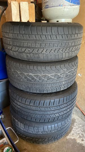 Cadillac rims and tires for Sale in Bolingbrook, IL
