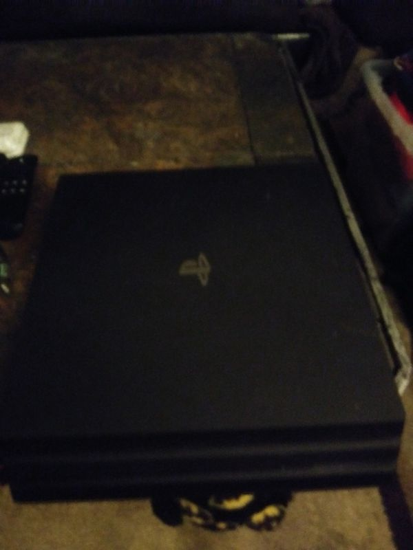 Ps4 Pro with a 2 controllers and 3 games only asking $120 OBO