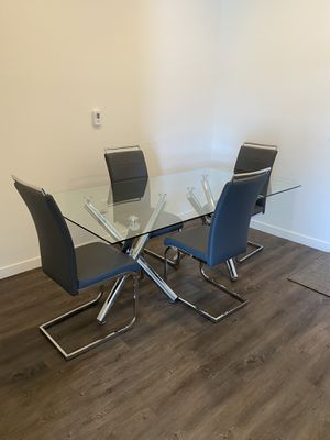 Glass table and 4 chairs. Like new 4 months old for Sale in Chandler, AZ