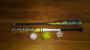 Baseball and softball bats and 3 balls for Sale in Long Beach, CA