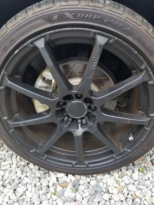Set of 4 used wheels and bran New tires 5 lugas universal side 235/40/18 Pattern 5x114. for Sale in Nashville, TN
