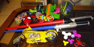 22 pieces boys toys includes maracas, football, light sabers, motorcycle, car, fidget spinners, spiderman light and more for Sale in Missouri City, TX
