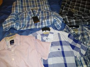 Selling 11 Mens' shirts new (w/tags) and gently used (Burberry, Levi, American Eagle, rocker styles, etc ) for Sale in St. Louis, MO