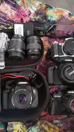 Canon EOS rebel t4i, canon ebel EOS t3i, Sony super steady shot 5.1 mega pixel, minolta x-700, go pro hero 3+ silver addition selfie stick, charger for Sale in Seattle, WA