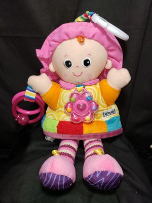 Lamaze Doll baby activity toy . Rattles , crinkles , rings and clip to hook to stroller or anywhere for Sale in Zanesville, OH