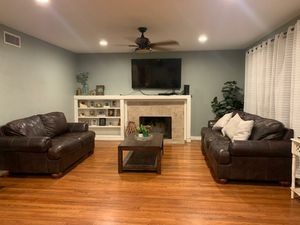Ashley Furniture Real Leather Brown Couches, Coffee table, 2 end tables, and Console table. for Sale in Riverside, CA