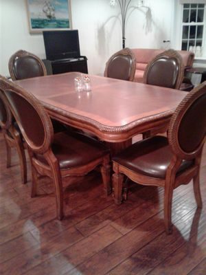 Fashion dining set large table with two extended piece what's 8 chairs for Sale in Alexandria, VA
