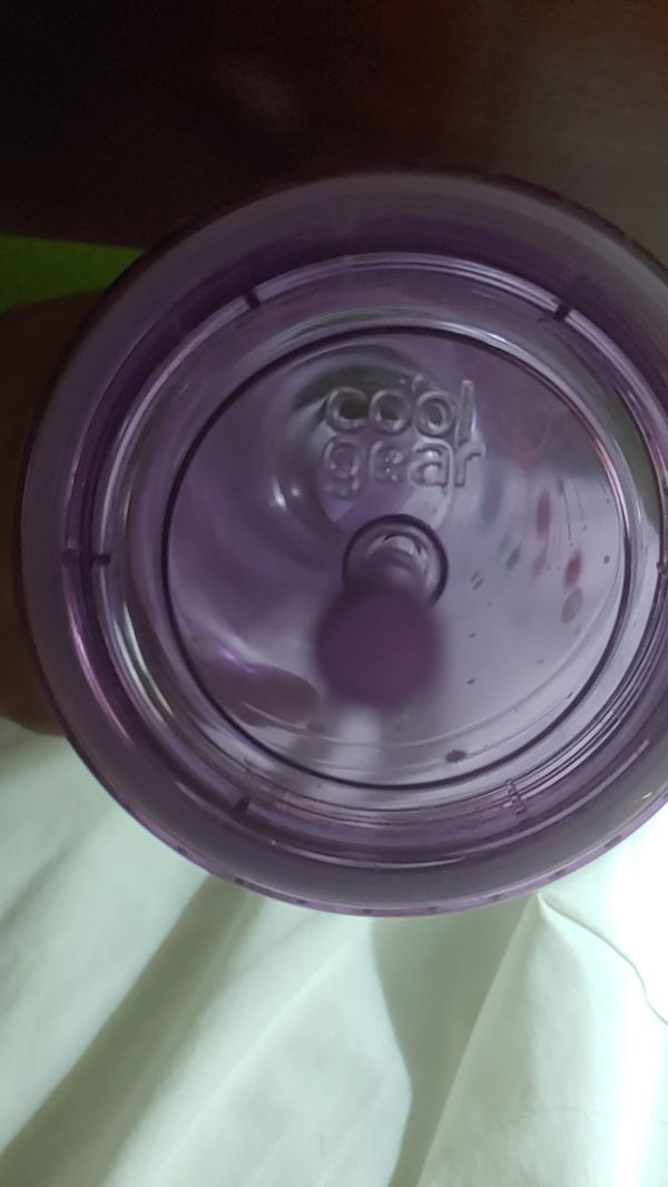 Coolgear 24oz insulated cup with lid and durable straw.