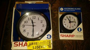 Sharp alarm clock new in box asking $ 3 large $2 small for Sale in Phoenix, AZ