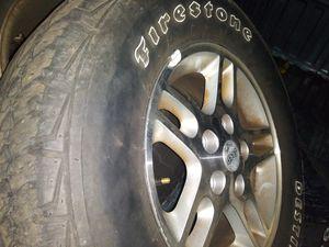 245/75/16s. Firestones. 80 percent tread on jeep wheels for Sale in North Providence, RI