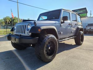 2014 Jeep Wrangler Unlimited 4WD for Sale in Orlando, FL