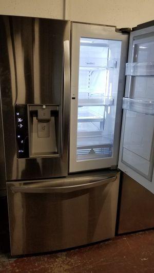 Lg refrigerator 3door stainless steel with custom door for Sale in San Antonio, TX