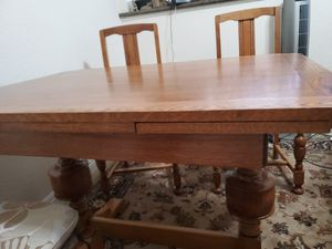 Antique Tiguer wood table and 4 chairs tablenexpand to seat 6 for Sale in Laguna Beach, CA