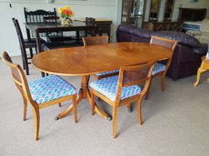 Dining table with leaf and 4 chairs mid century modern solid wood claw foot table for Sale in Tulsa, OK