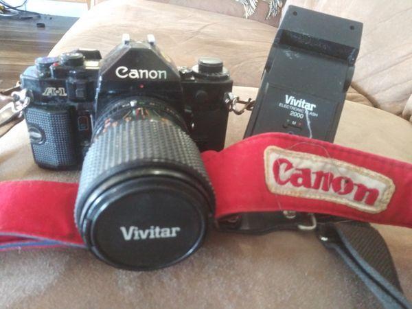 Canon A1 slr. film camera. 2 lenses 75-300