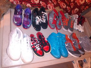 18 pairs of athletic youth and some men and ladies adidas Reebok heeleys two pair and rain boots for Sale in San Antonio, TX