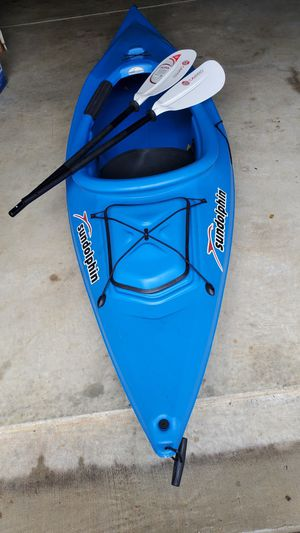 Sundolphin 10 foot sit in kayak with paddle. 2 years old, used twice. Sells new at $498.00, will sell for $325.00. for Sale in Sanford, NC
