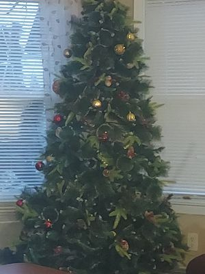 12 Ft. CHRISTMAS TREE. Including white lights and stand. Also Including Red and Gold Christmas tree skirt for Sale in Baldwin, NY